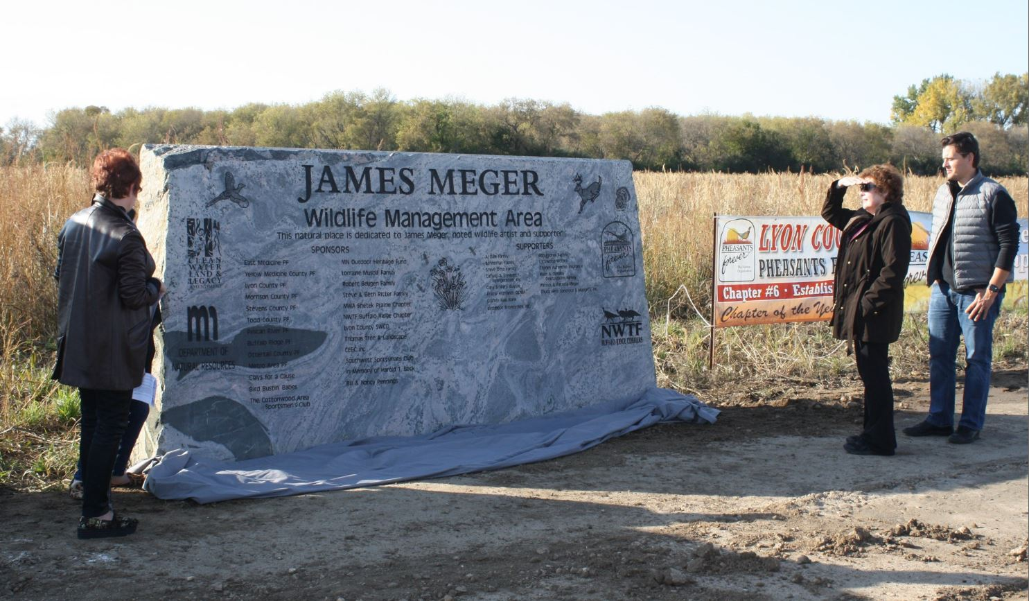 James Meger's family admire the stone monolith erected on the WMA's east side.